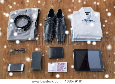 business, style, clothes and objects concept - close up of formal male clothes and personal stuff on wooden table at home over snow effect