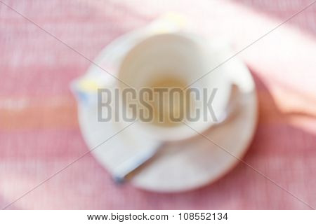 Blurred Photo Of Empty Coffee Cup After Finished Coffee Break Time.