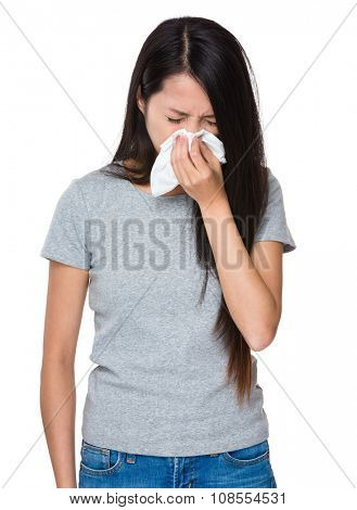 Asian Young Woman sneezing