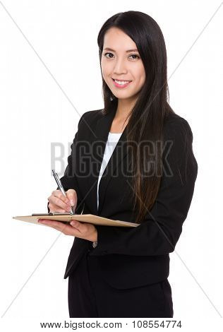 Young Businesswoman record on clipboard