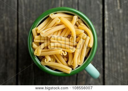 uncooked pasta caserecce in cup
