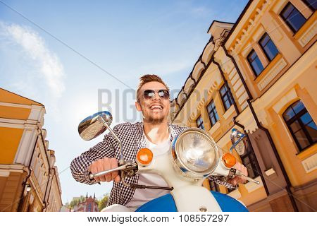 Handsome Cheerful Man With Sunglasses Riding A Scooter