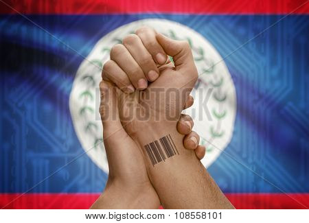 Barcode Id Number On Wrist Of Dark Skinned Person And National Flag On Background - Belize