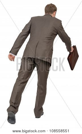 Running businessman with suitcase