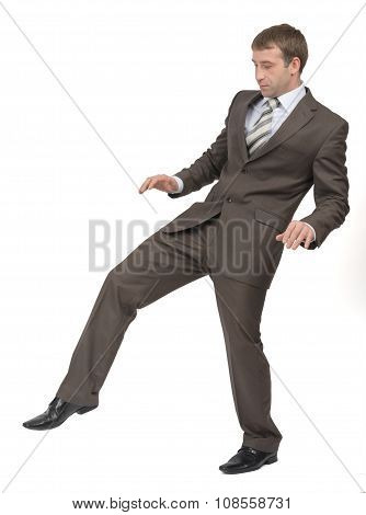 Businessman walking gingerly