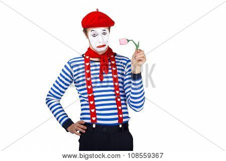 Mime with flower.Emotional funny actor wearing sailor suit, red beret posing on white isolated backg