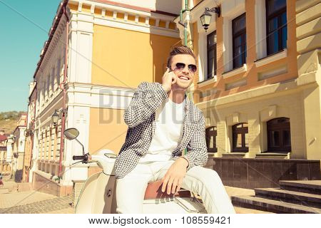Handsome Man Sitting On The Motorbike Talking On The Phone