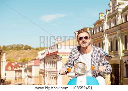 Handsome Man Riding A Scooter On The Street