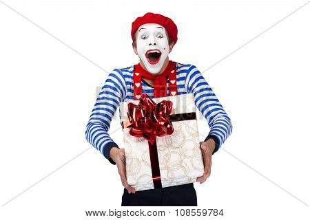 Mime with present.Emotional funny actor wearing sailor suit, red beret posing on white isolated back