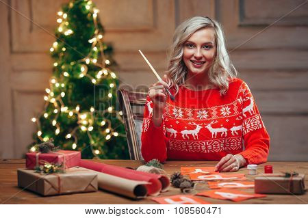 woman painting christmas flags with brush