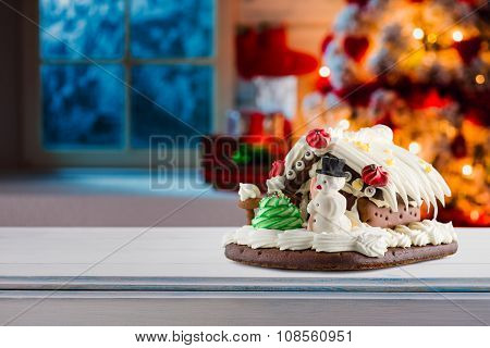 Gingerbread House On Wooden Table. Christmas Decoration.
