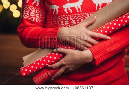 woman hands closeup holding wrapping kraft paper for gifts