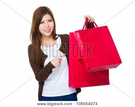 Woman finger point to the shopping bag
