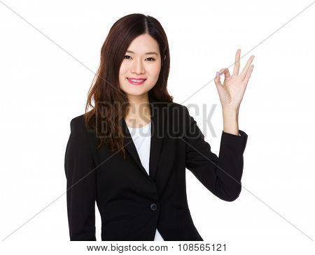 Young Businesswoman with ok sign gesture