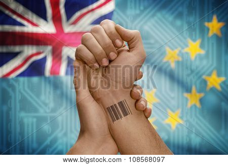 Barcode Id Number On Wrist Of Dark Skinned Person And National Flag On Background - Tuvalu