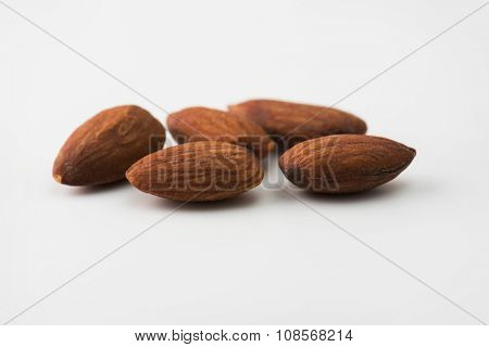 Almonds isolated on natural white background. Shallow depth of field.