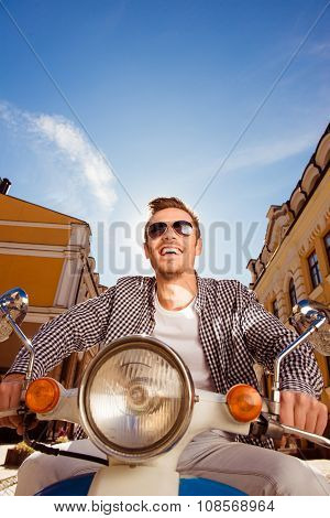 Handsome Cheerful Man With Sunglasses Riding A Motorbike