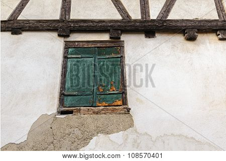 Fragment Of An Old Half-timbered House With Window Shuttered