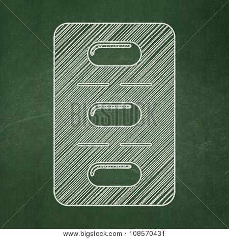 Healthcare concept: Pills Blister on chalkboard background