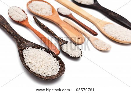Set of different wooden spoons with white rice