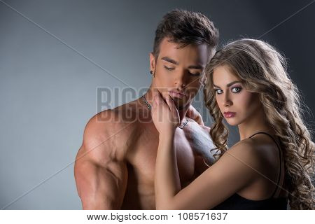 Portrait of sexy hunk and girl with beautiful eyes
