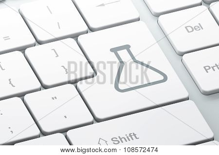Science concept: Flask on computer keyboard background