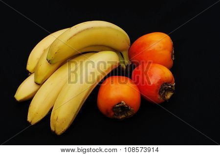 Fresh fruits on black background. Summer background. Raw and vegetarian eating background. pomegrana