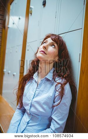 Mature student feeling stressed in hallway at the university