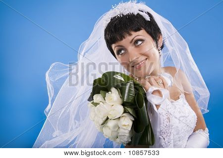 One Happy And Beautiful  Bride On Blue Background.