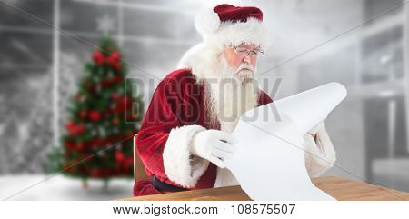 Santa reads a long list against home with christmas tree