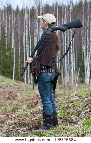 Woman Hunter In Spring Forest