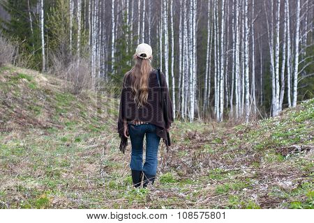 Woman Hunter Walking In The Forest