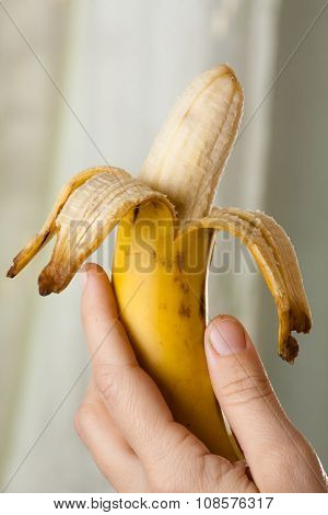 Hand With Half-peeled Yellow Banana