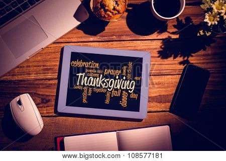 Thanksgiving words against shirt shoes jean glasses next to wallet smartphone and bag