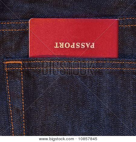 Dark Blue Jeans Pocket With Red Passport