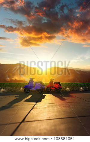 Two scooter with mountain scenery in the background.