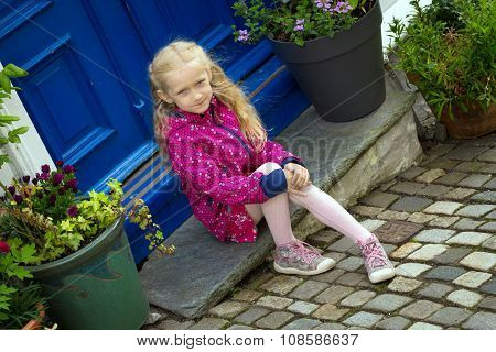 Girl Sitting On The Porch