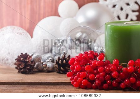 Christmas Composition With Candles And Viburnum