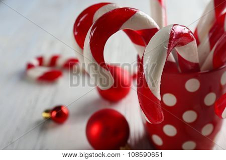Christmas Candy Canes in cup on table close-up