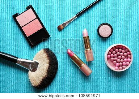 Different cosmetics on blue background