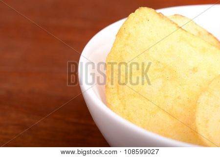 Crispy Potato Chips Close Up On White Plate