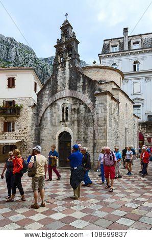 Group Of Tourists Near Church Of St. Luke, Kotor, Montenegro