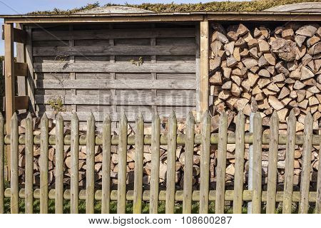 Stack Of Firewood At The Half-filled On A Sunny Day