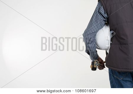 Rear View Of A Contractor Standing On White With Copy Space