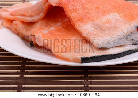 Raw Salmon Fish Steaks With Fresh Herbs On White Plate