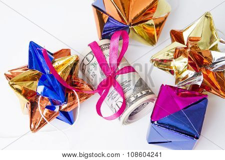 Money With Red Ribbon On A White Background