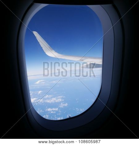 View of blue sky from airplane window. (2)