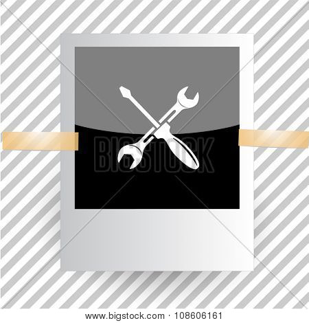 screwdriver and spanner. Photoframe. Raster icon.
