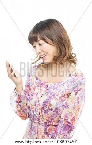 Beautiful asian woman using a cellular