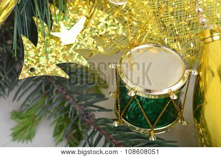 Christmas Background With Drums, Green Eve Tree Branch, Golden New Year Decoration